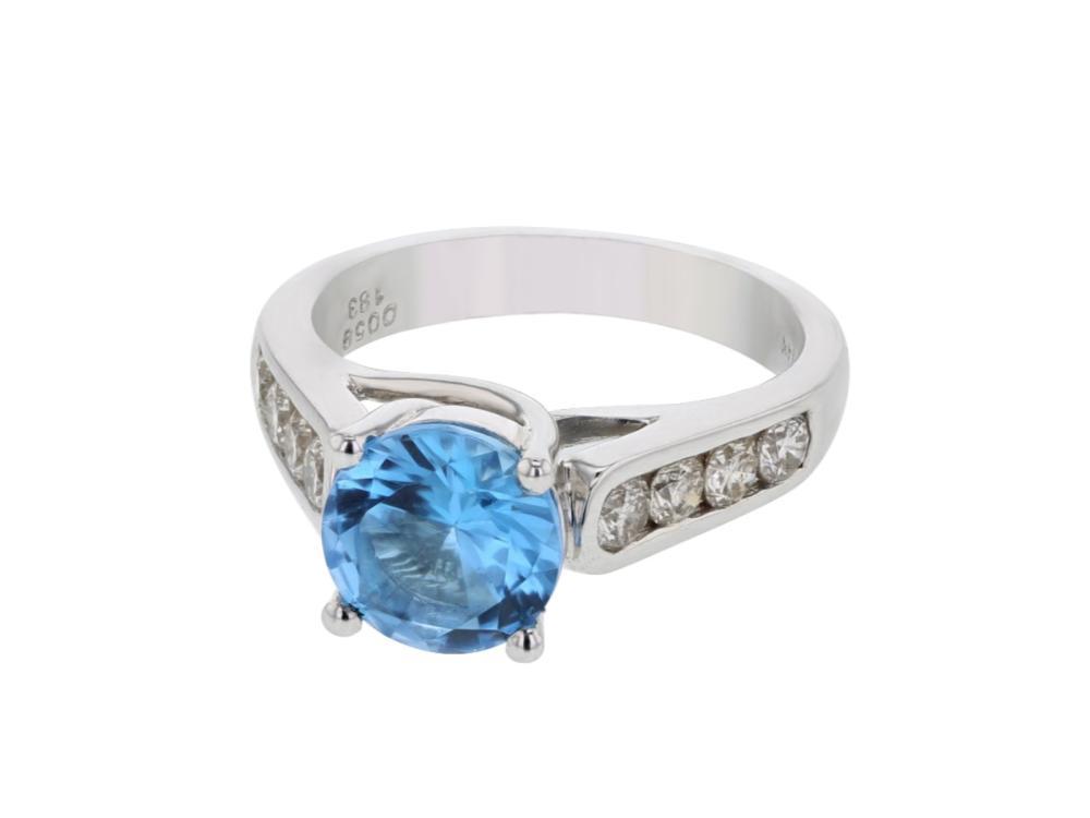 18KT White Gold 1.60ct Blue Topaz and Diamond Ring