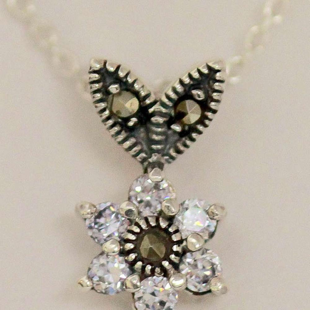 .925 STERLING SILVER FLOWER PENDENT W/ CLEAR CZ