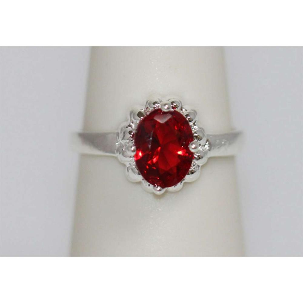 Lot 1041: RED CZ .925 STERLING SILVER RING