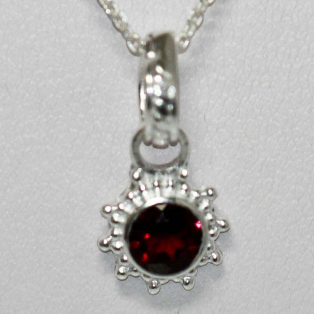 BEAUTIFUL SILVER PENDANT WITH RED RUBY STONE CTW 0.60