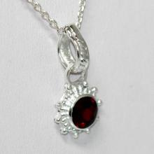 Lot 1146: BEAUTIFUL SILVER PENDANT WITH RED RUBY STONE CTW 0.60
