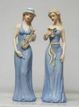 Beautiful Set of 2 Porcelain women figurines holding in
