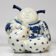 PORCELAIN PERSON PLAYING W/ FEET