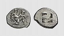 THRACE, A SILVER STATER OF THASOS, ca. 480 BC, 9.570g. Hirmer 435. Old cabinet tone. Perfectly centered and unusually struck on a broad flan. Lovely archaic style. Choice extremely fine. Acquired privately from Tradart; The Numismatic Auction 1983
