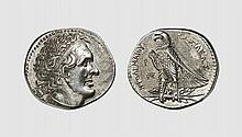 EGYPT, A SILVER TETRADRACHM OF PTOLEMY I, signed by the Master Δ, Alexandreia, ca. 305-285 BC, 14.269g, 12h. Svoronos 255. Old cabinet tone. Perfectly centered and struck on a broad flan. Among the finest known. Superb extremely fine. Acquired