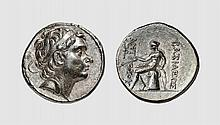 SYRIA, A SILVER TETRADRACHM OF ANTIOCH III, Antioch, ca. 204-197 BC, 17.114g, 12h. SC 1044.1. Old cabinet tone. Perfectly centered. Struck in high relief from artistic dies. Superb extremely fine. Acquired privately from Tradart