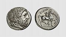 MACEDON, A SILVER TETRADRACHM OF PHILIP II, Amphipolis, ca. 359-336 BC, 14.319g, 11h. Le Rider 421. Old cabinet tone. Perfectly centered and struck. Attractive early Hellenistic style. Virtually as struck and almost Fdc. Acquired privately from