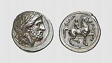 MACEDON, A SILVER TETRADRACHM OF PHILIP II, Pella, ca. 359-336 BC, 14.488g, 12h. Le Rider 276 = Nanteuil 796 (this coin). Exceptional broad flan. With a particularly elegant head of Zeus of the finest late classical style. Choice extremely fine.
