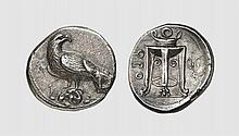 BRUTTIUM, A SILVER NOMOS OF KROTON, ca. 400 BC, 7.626g, 9h. SNG ANS 343. Rare. Old cabinet tone. Perfectly centered and struck. Usual die-break on obverse, otherwise, choice extremely fine. Acquired privately from Tradart; Bank Leu 1987 (42) lot 64;