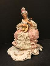 Dresdon Figurine. Girl seated with mandolin.