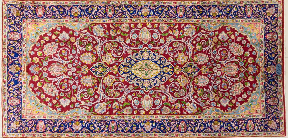 A Persian Hand Knotted Kerman Rug, 300 x 145