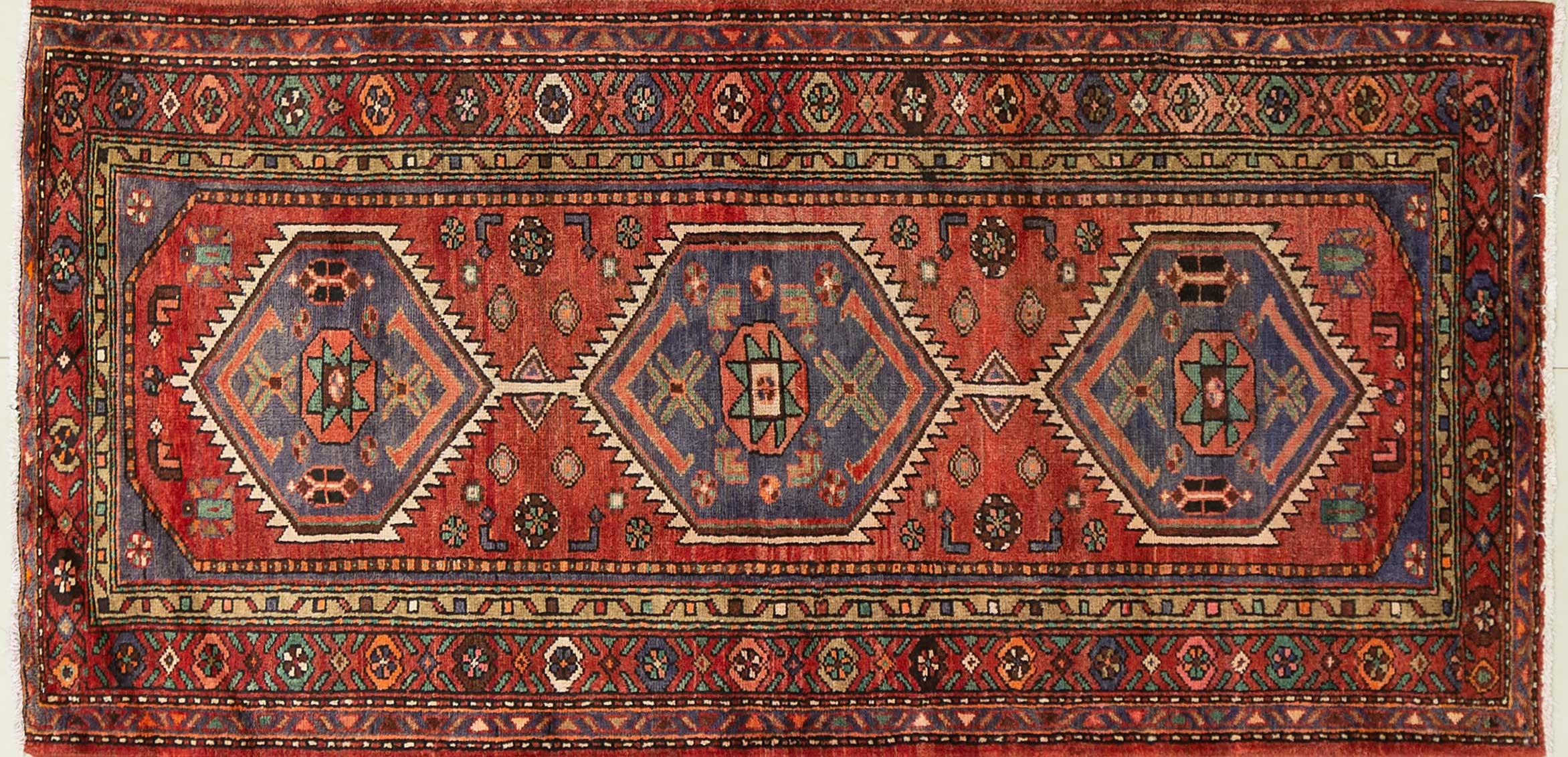 A Persian Hand Knotted Hamadan Rug, 206 x 100