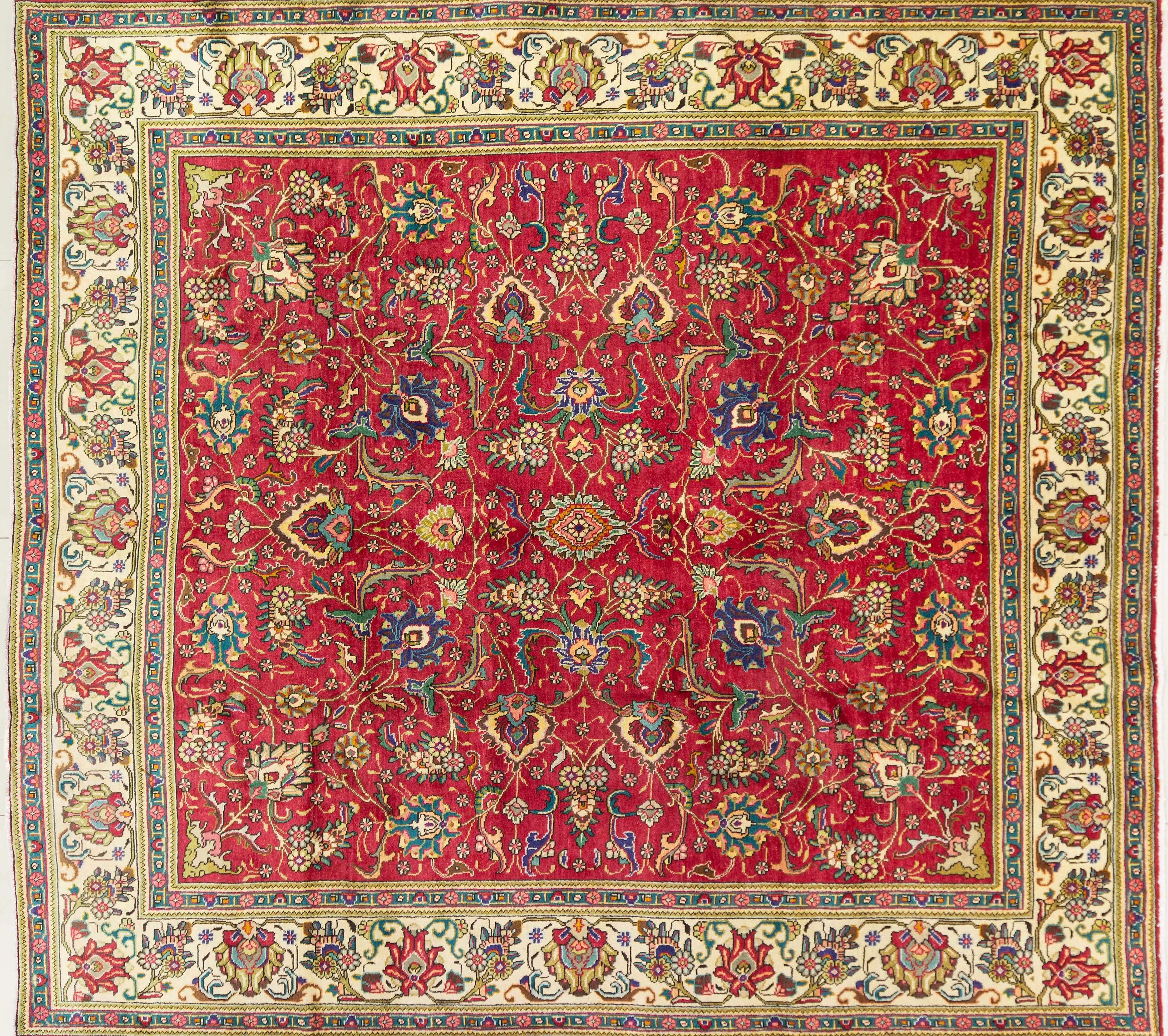A Persian Hand Knotted Tabriz Carpet, 323 x 297
