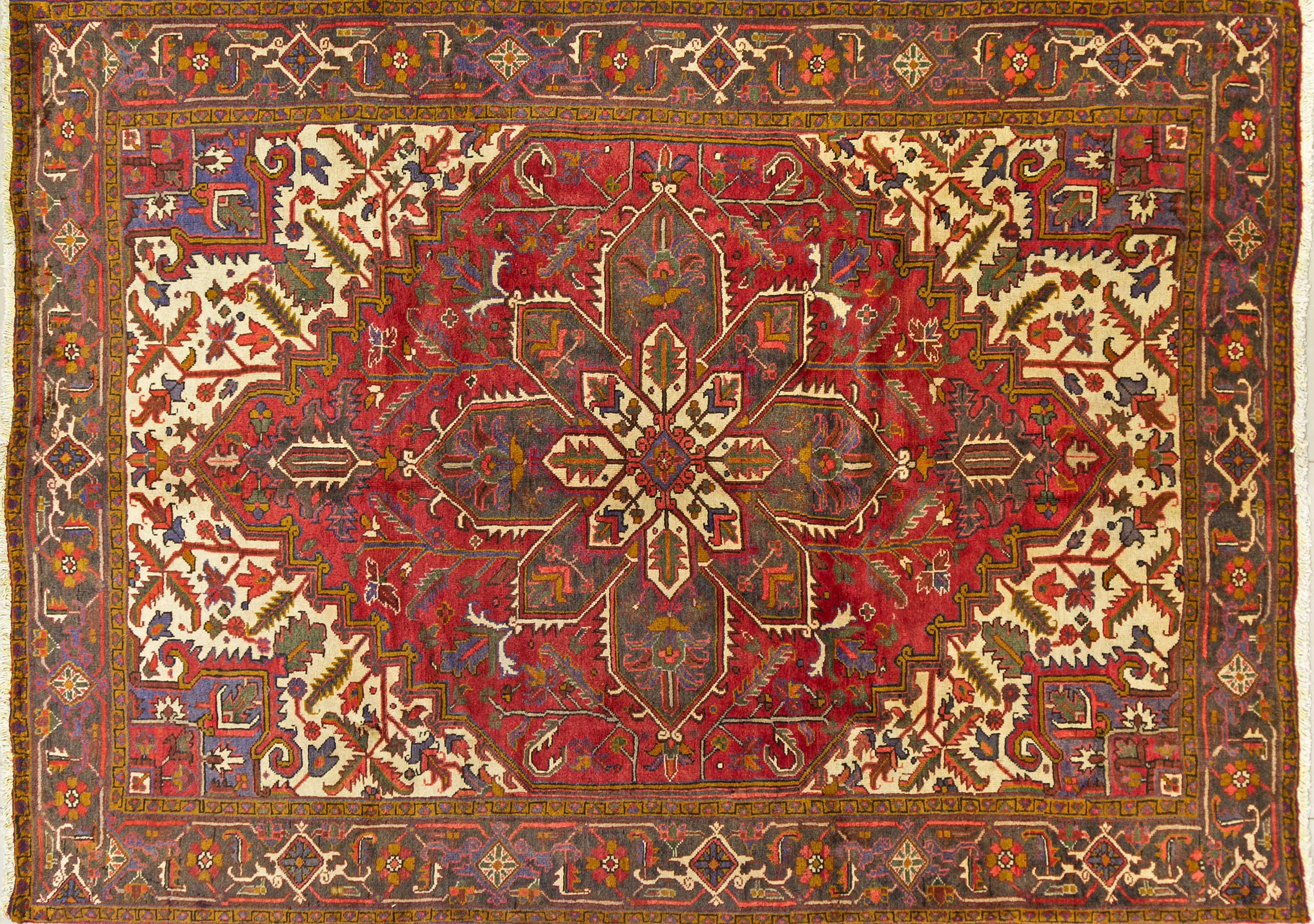 A Persian Hand Knotted Heriz Carpet, 295 x 215