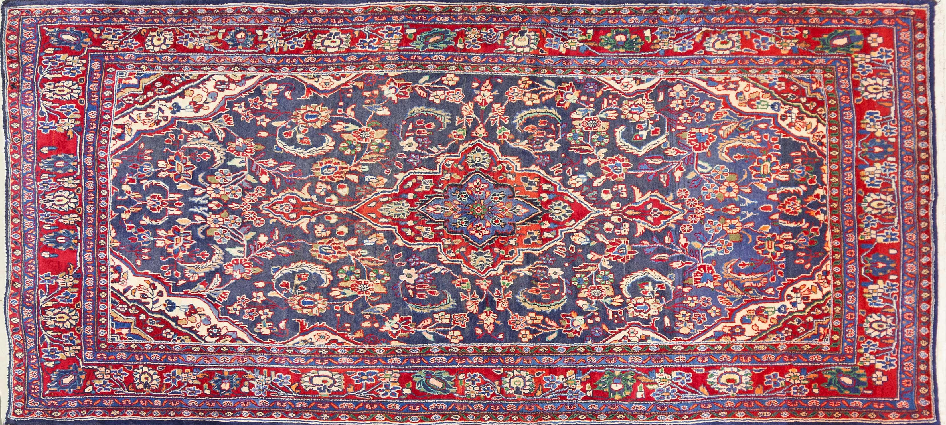 A Persian Hand Knotted Hamadan Rug, 293 x 123