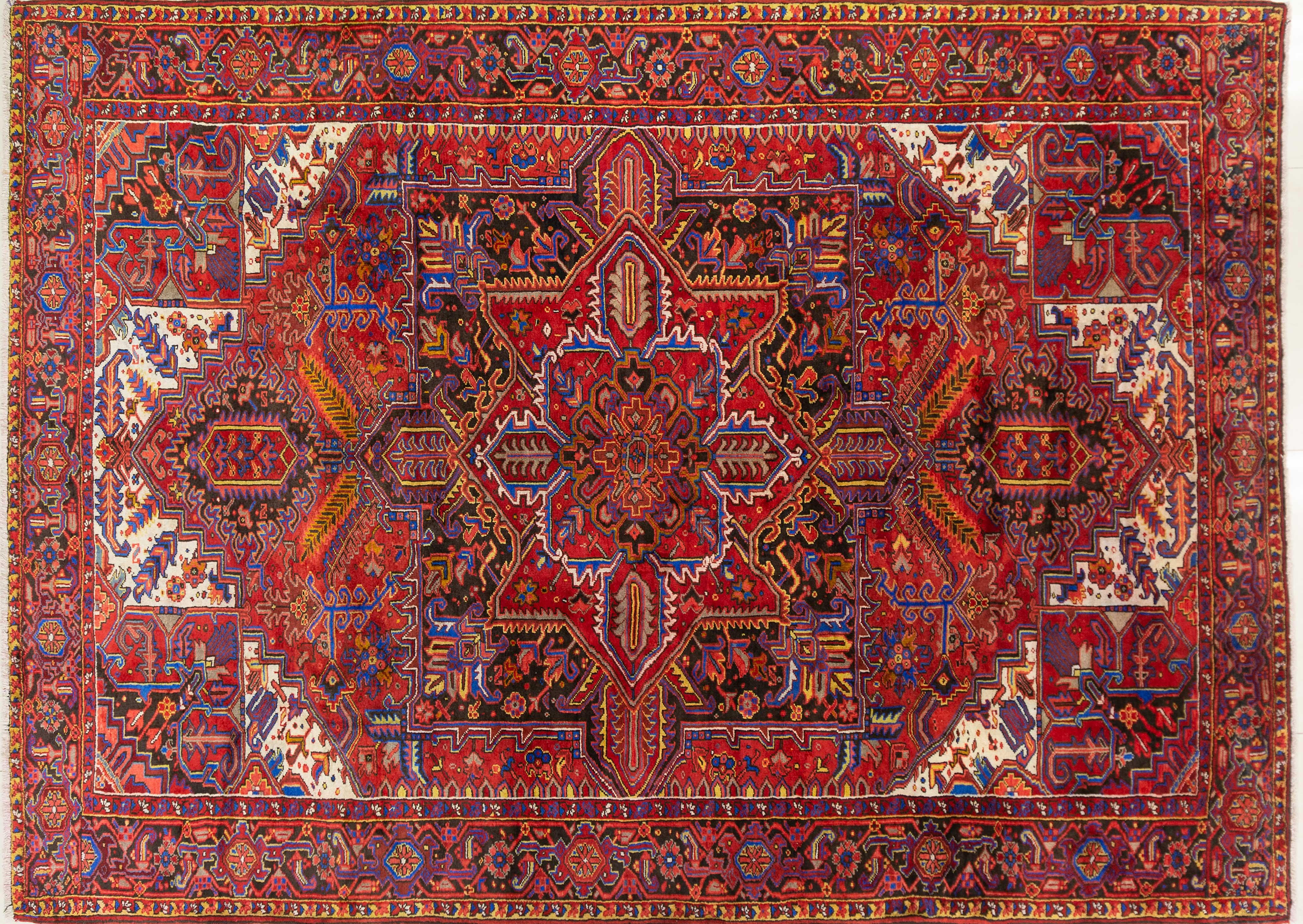 A Persian Hand Knotted Heriz Carpet, 362 x 264
