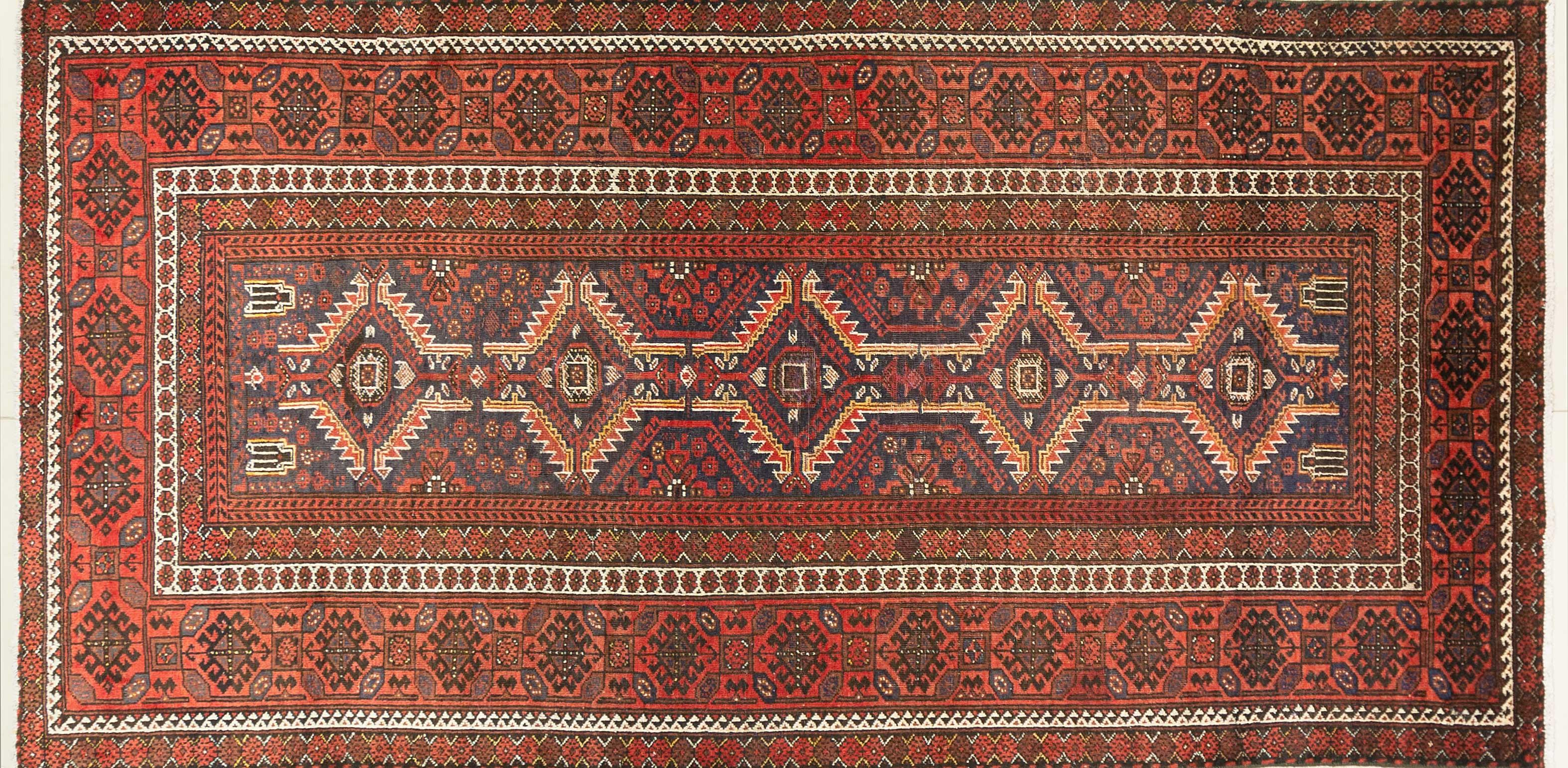 A Persian Hand Knotted Beluchi Rug, 270 x 133