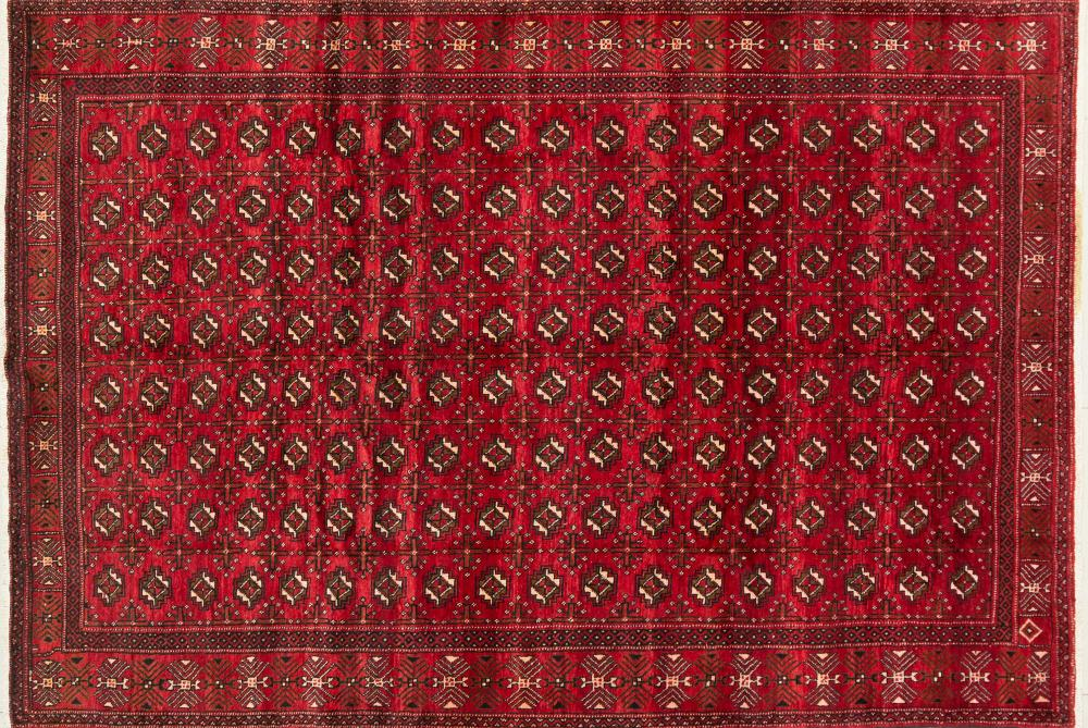 A Persian Hand Knotted Turkaman Carpet, 305 x 205
