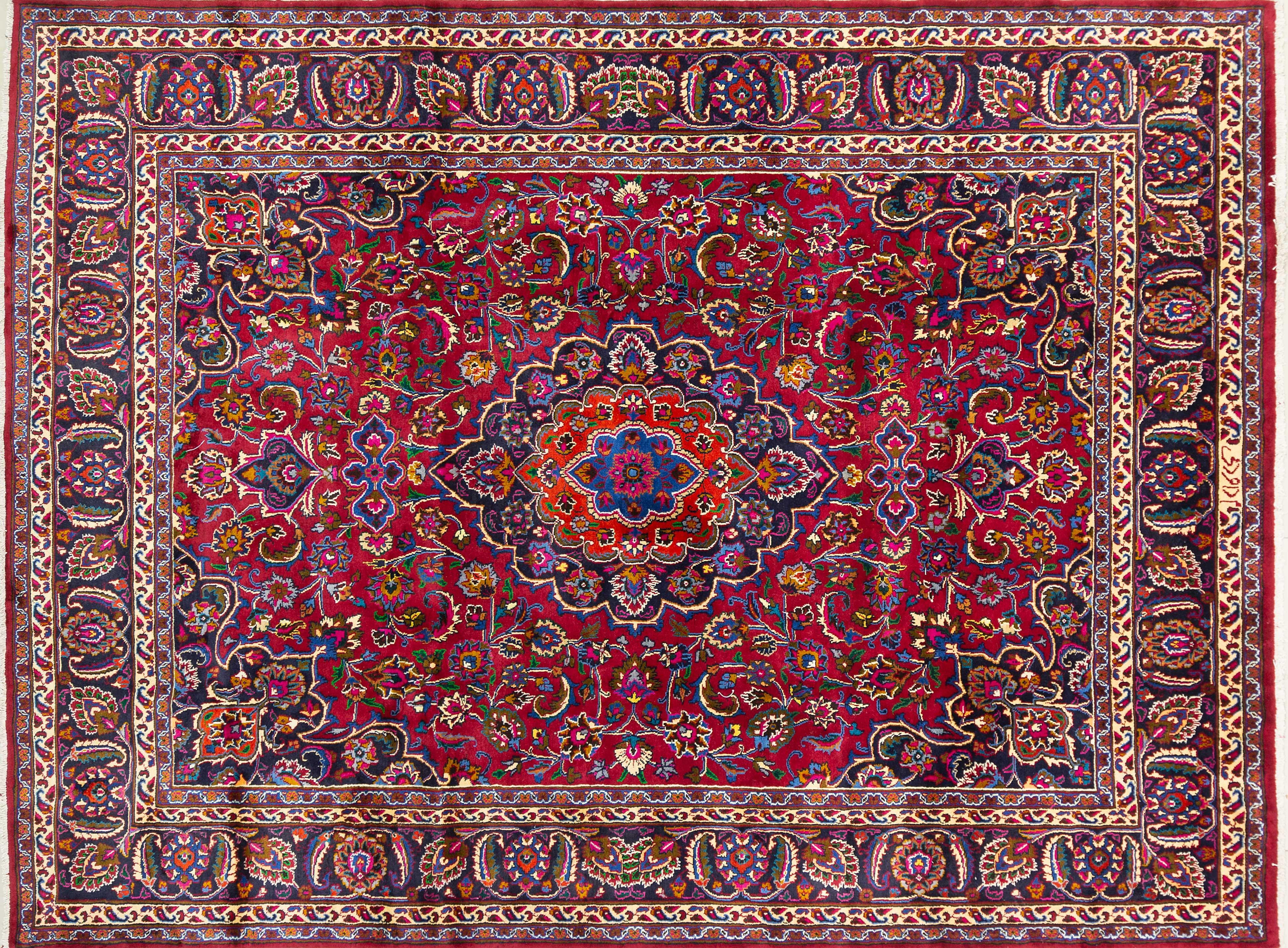 A Persian Hand Knotted Mashad Carpet, 338 x 250