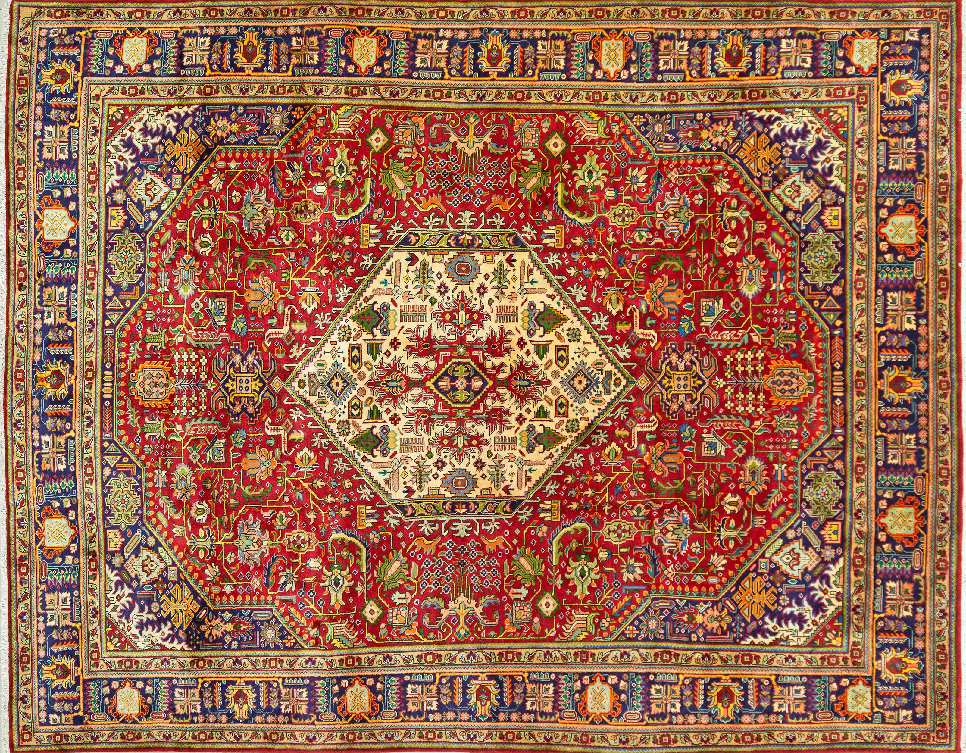 A Persian Hand Knotted Tabriz Carpet, 372 x 292