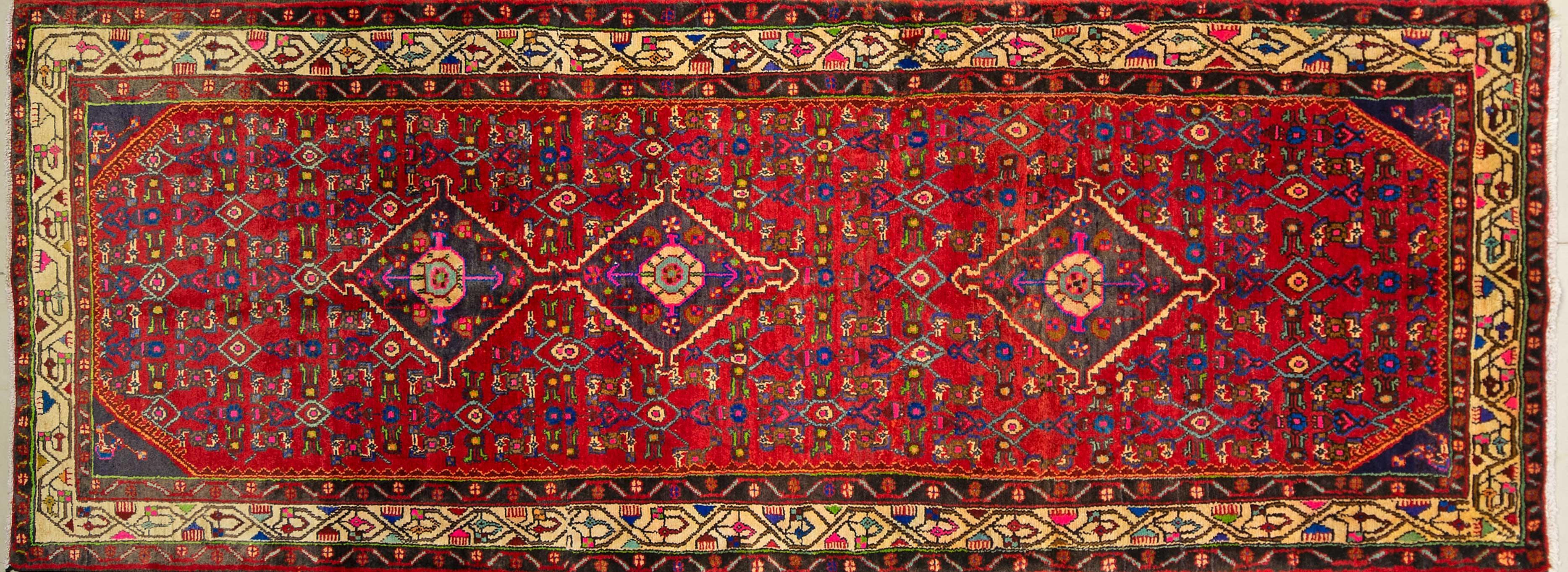 A Persian Hand Knotted Hamadan Carpet, 300 x 115
