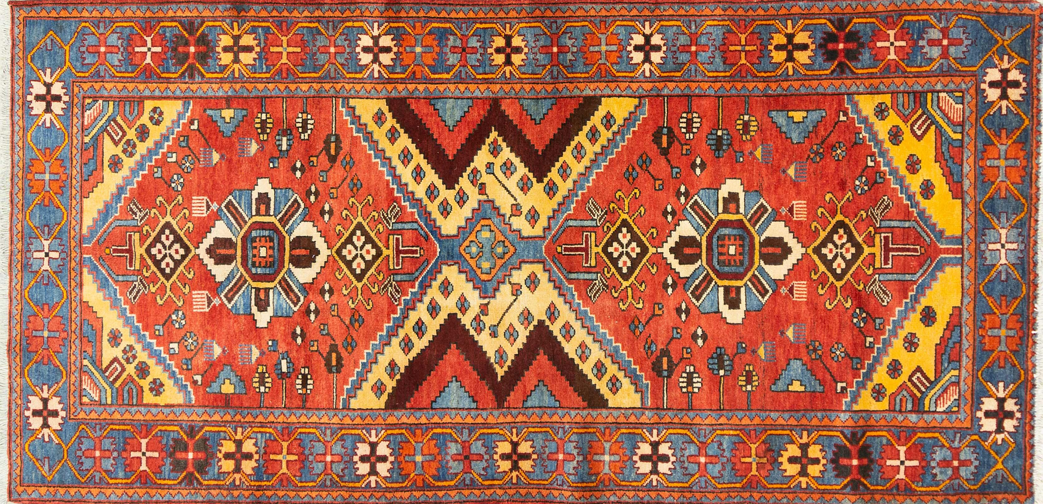 A Persian Hand Knotted Hamadan Carpet, 290 x 137