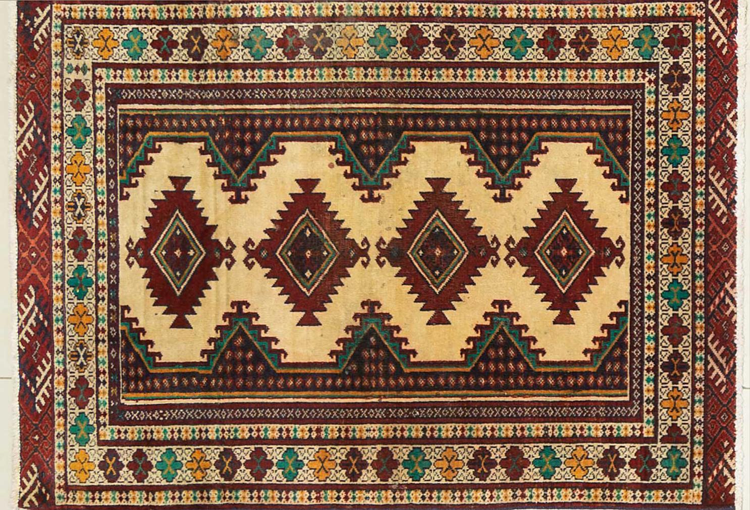 A Persian Hand Knotted Turkaman Rug, 120 x 85