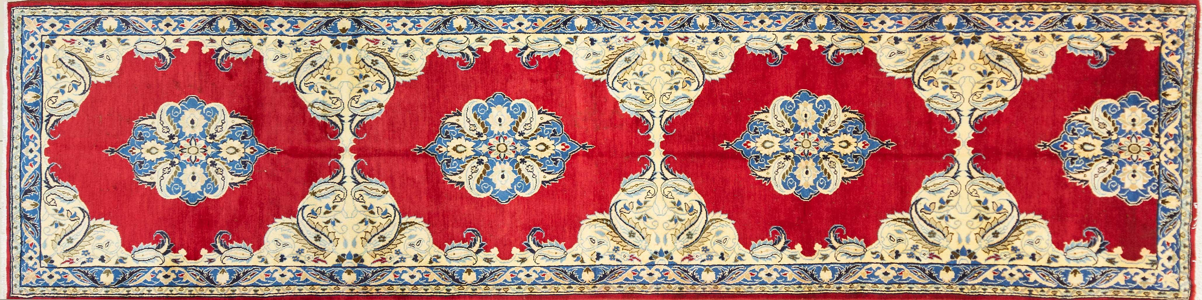 A Persian Hand Knotted Kerman Runner, 385 x 100