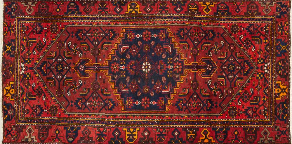 A Persian Hand Knotted Zanjan Rug, 254 x 127