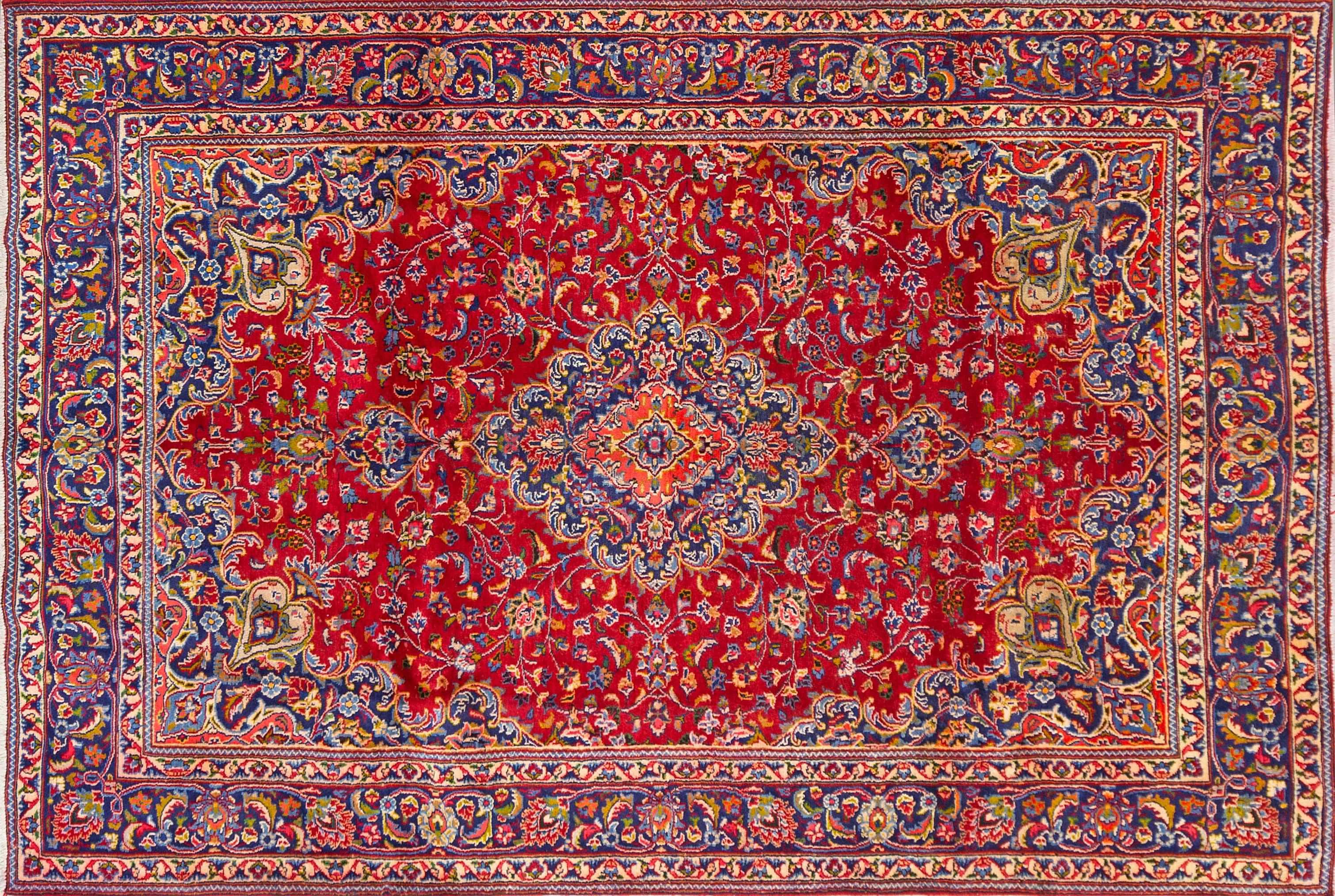 A Persian Hand Knotted Mashad Carpet, 280 x 190