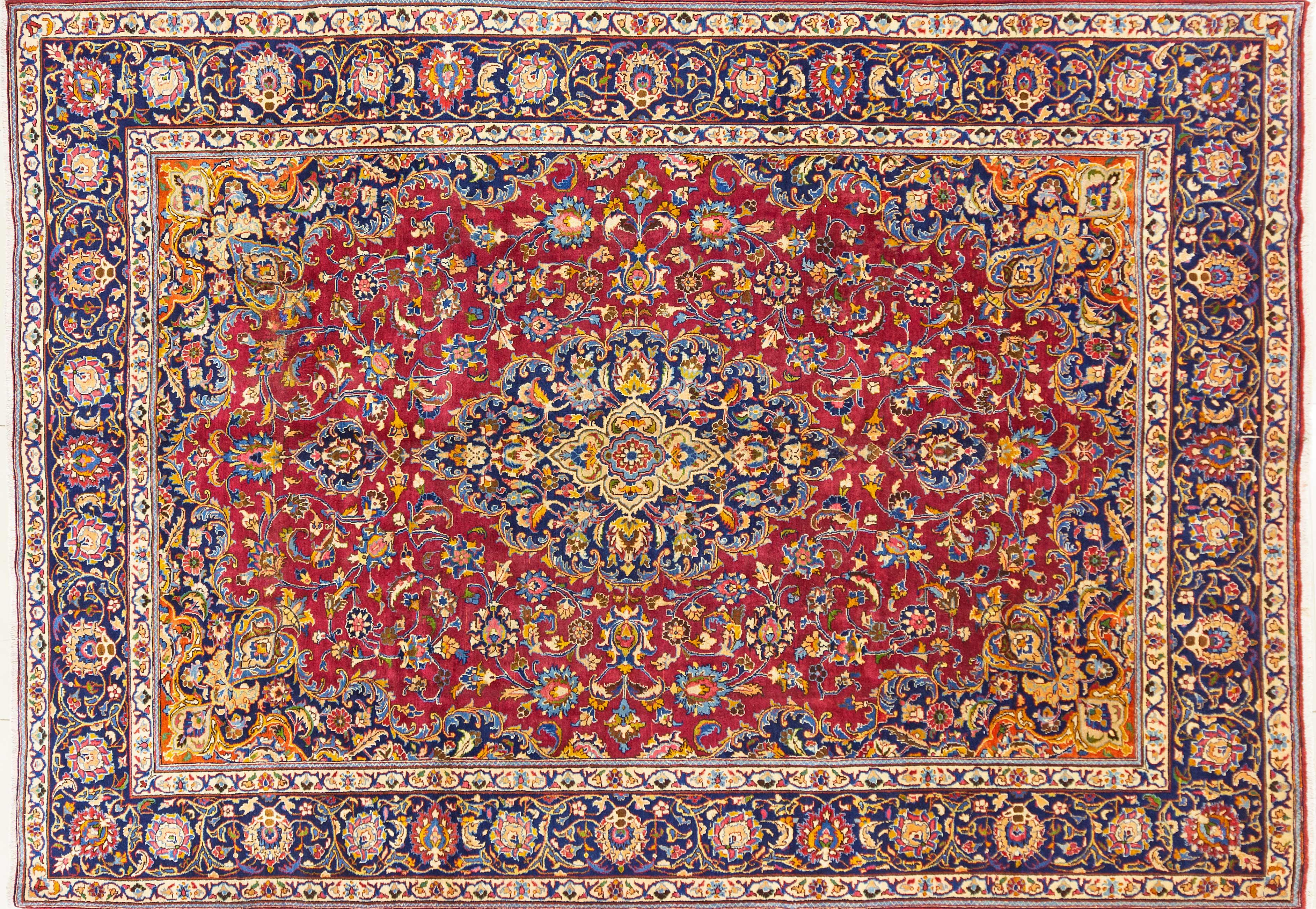 A Persian Hand Knotted Mashad Carpet, 346 x 242