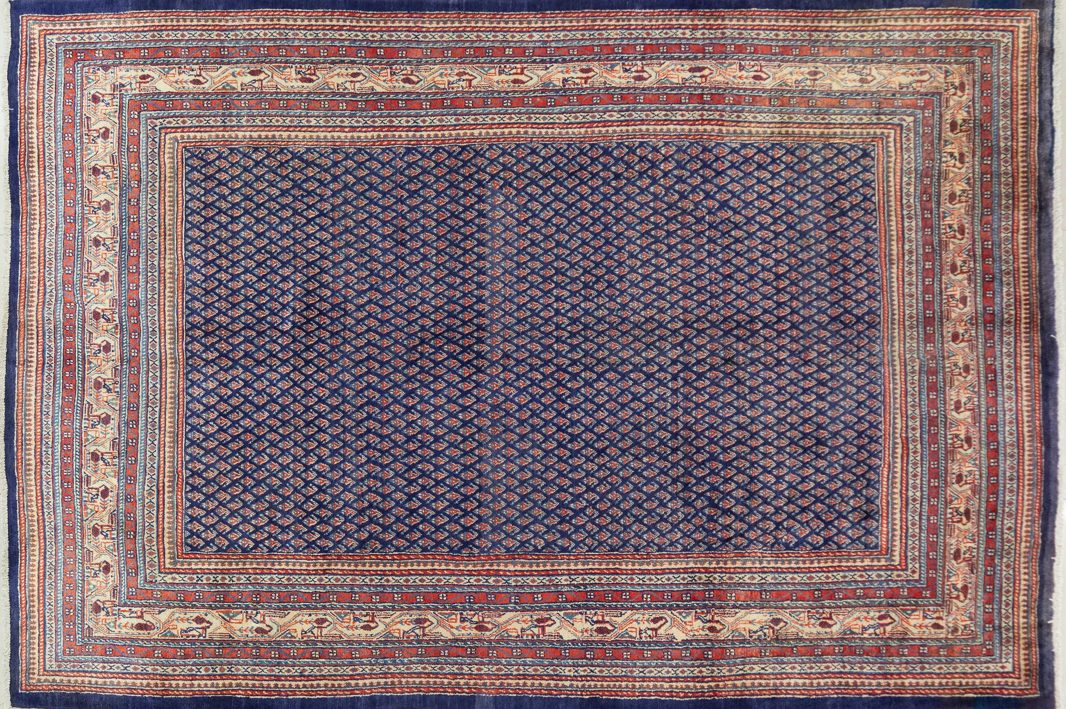 A Persian Hand Knotted Mir Carpet, 307 X 217