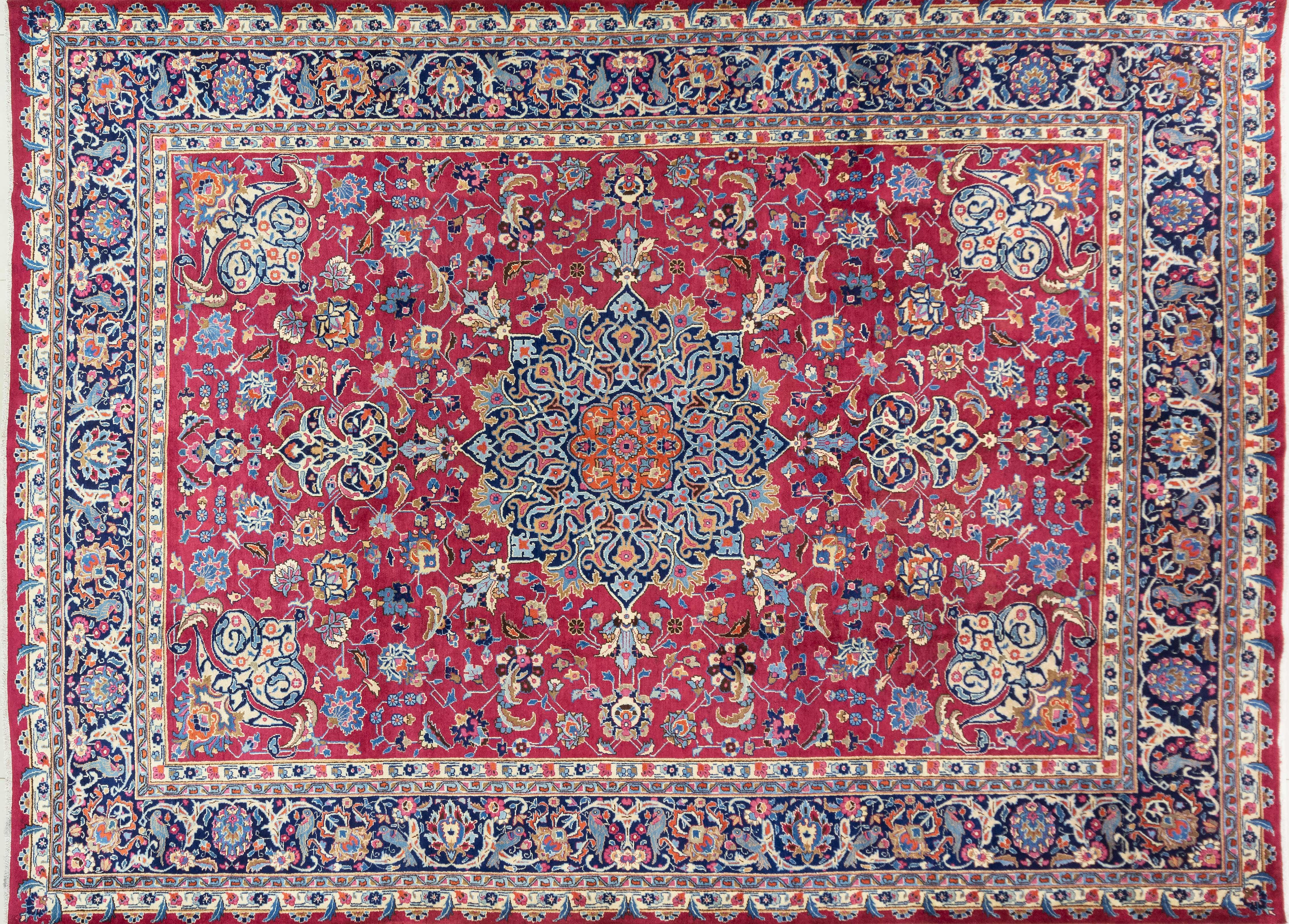 A Persian Hand Knotted Mashad Carpet, 394 X 292