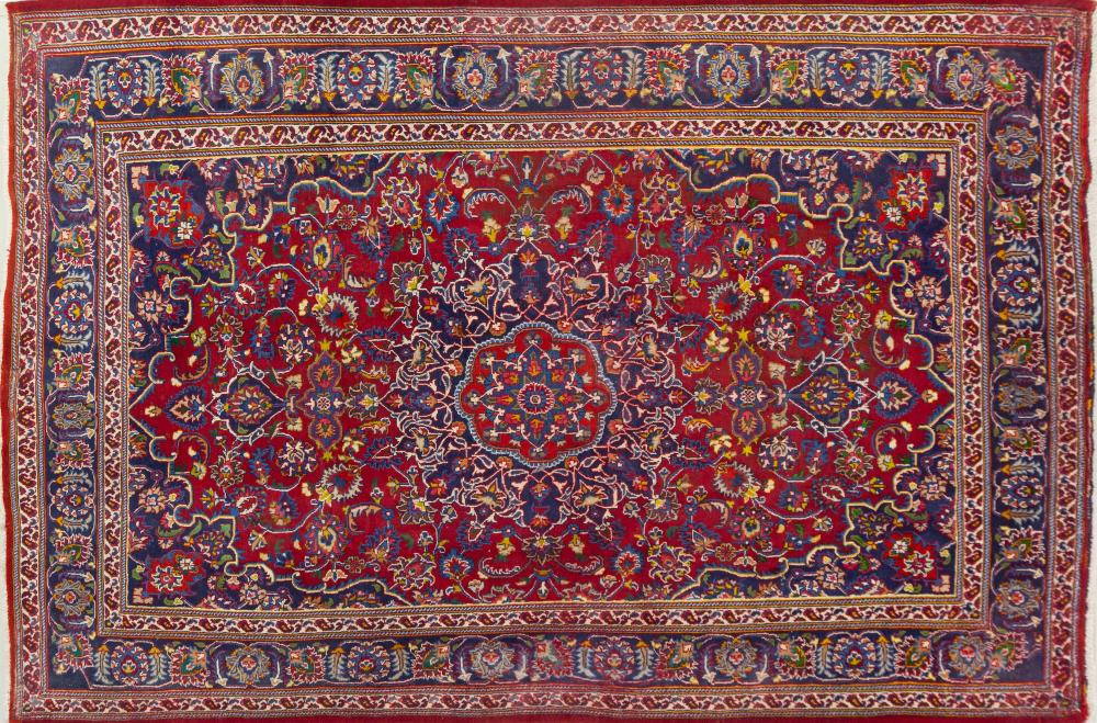 A Persian Hand Knotted Mashad Carpet, 310 X 211