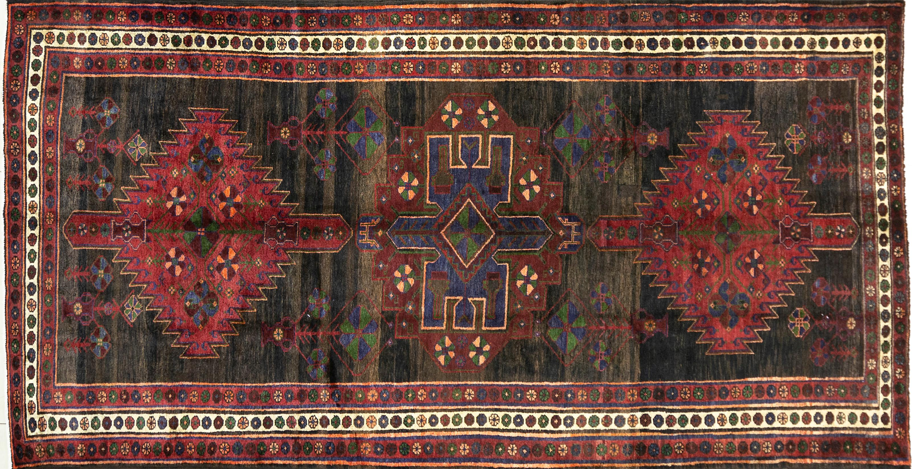 A Persian Hand Knotted Hamadan Rug, 280 x 147