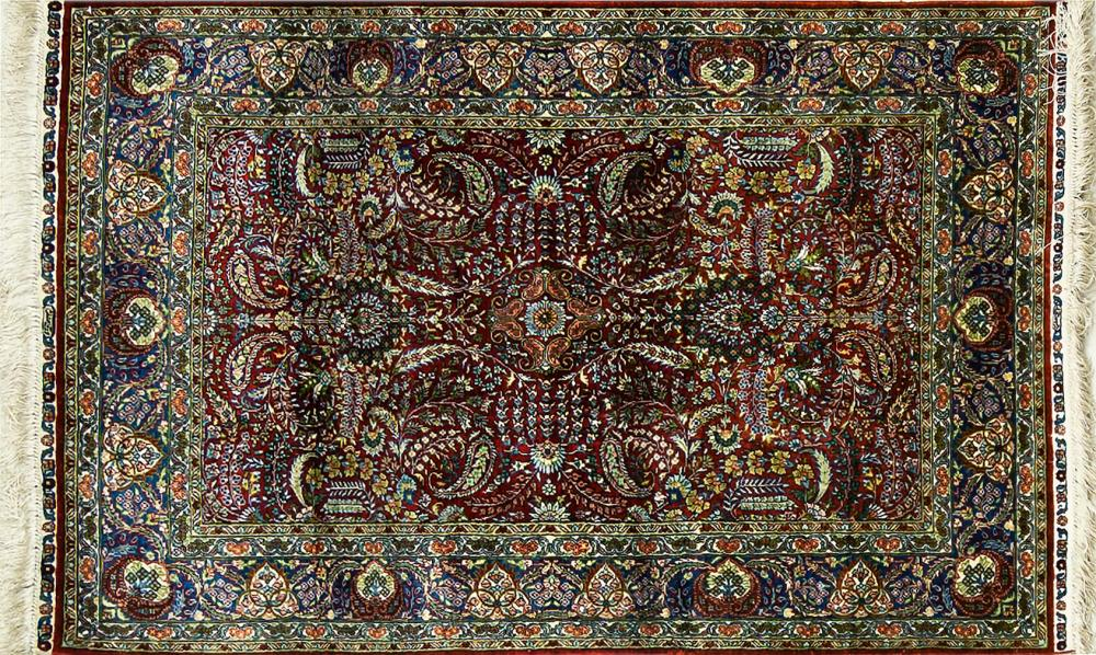 A Hand Knotted Chinese Silk Rug, 122 x 77