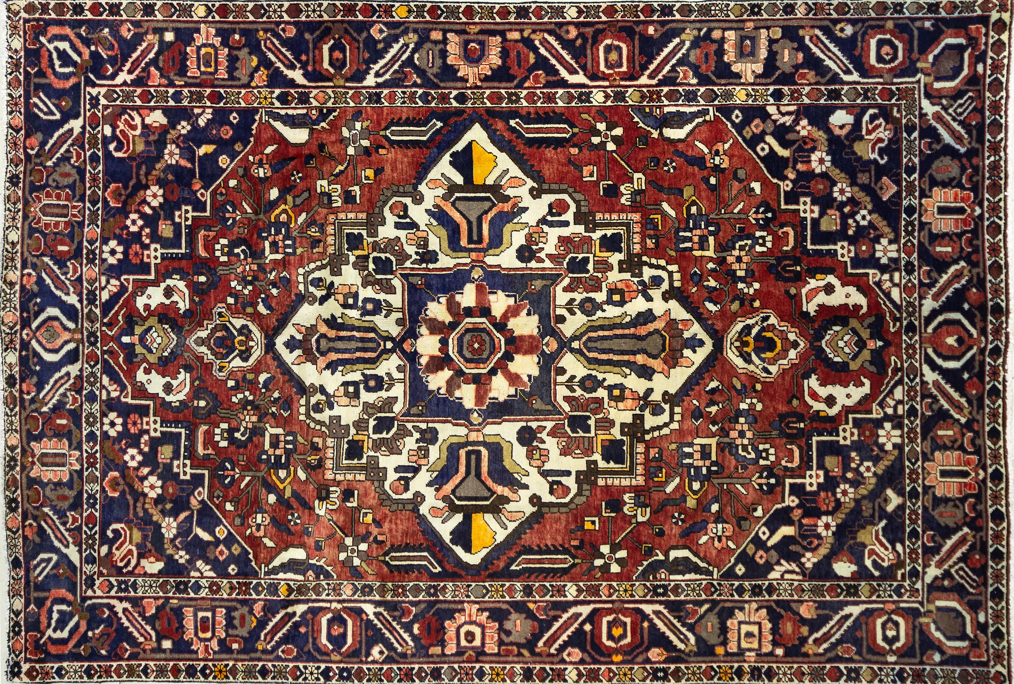 A Persian Hand Knotted Bakhtiari Carpet, 310 x 210