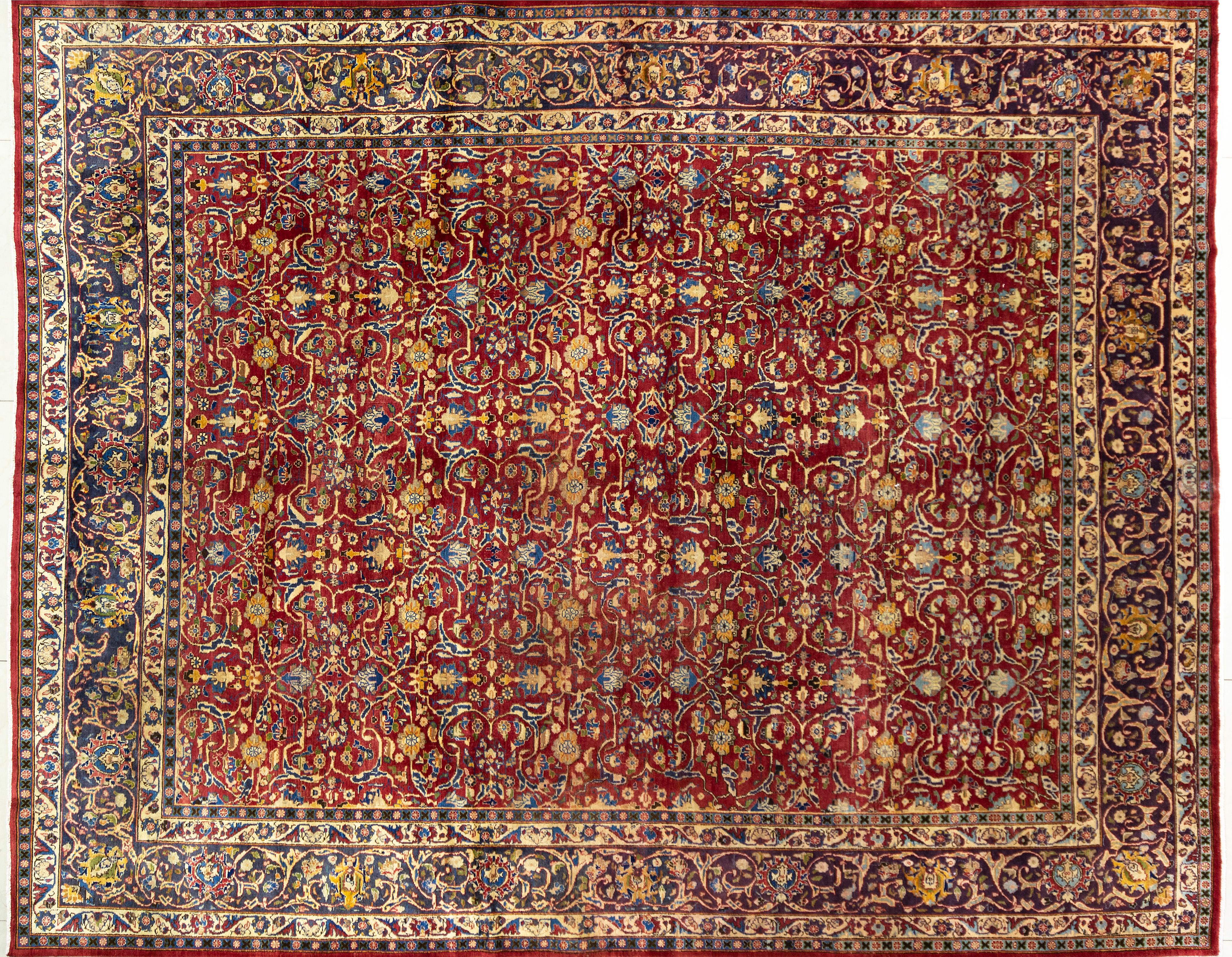 A Persian Hand Knotted Mashad Carpet, 370 x 295