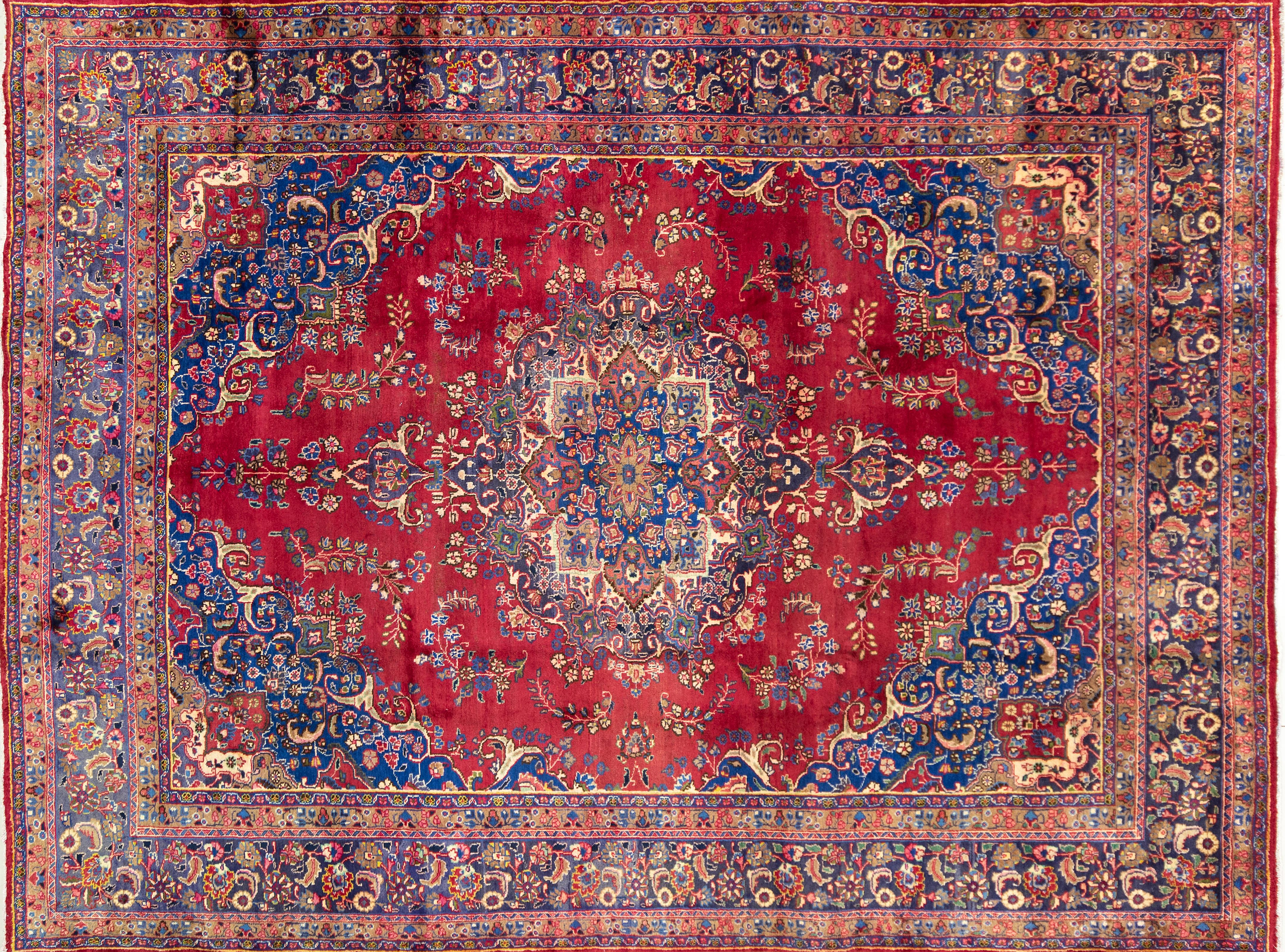 A Persian Hand Knotted Mashad Carpet, 390 x 291