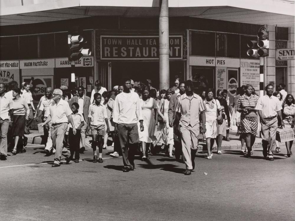 "David Goldblatt HonFRPS (SA 1930 – 2018) Photograph, ""Saturday Morning at the Corner of Commissioner and Trichardt Streets Boksburg"", Signed & Dated 4/79 from an Edition of 100, 38 x 38"