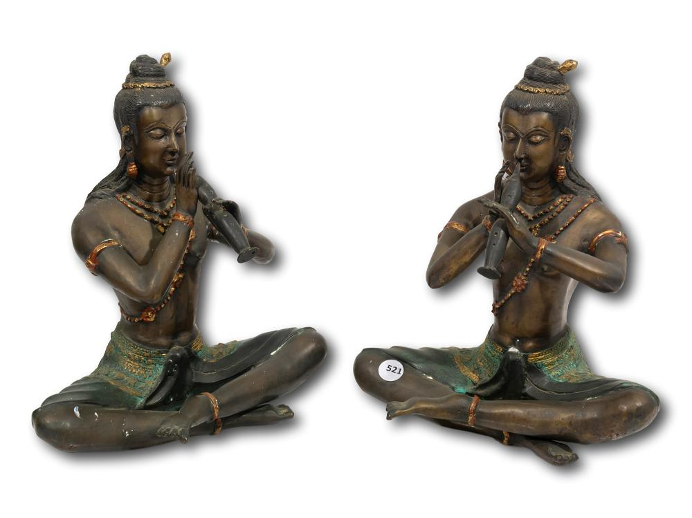 A Pair of Indian Spelter Flute Players, 28cm each