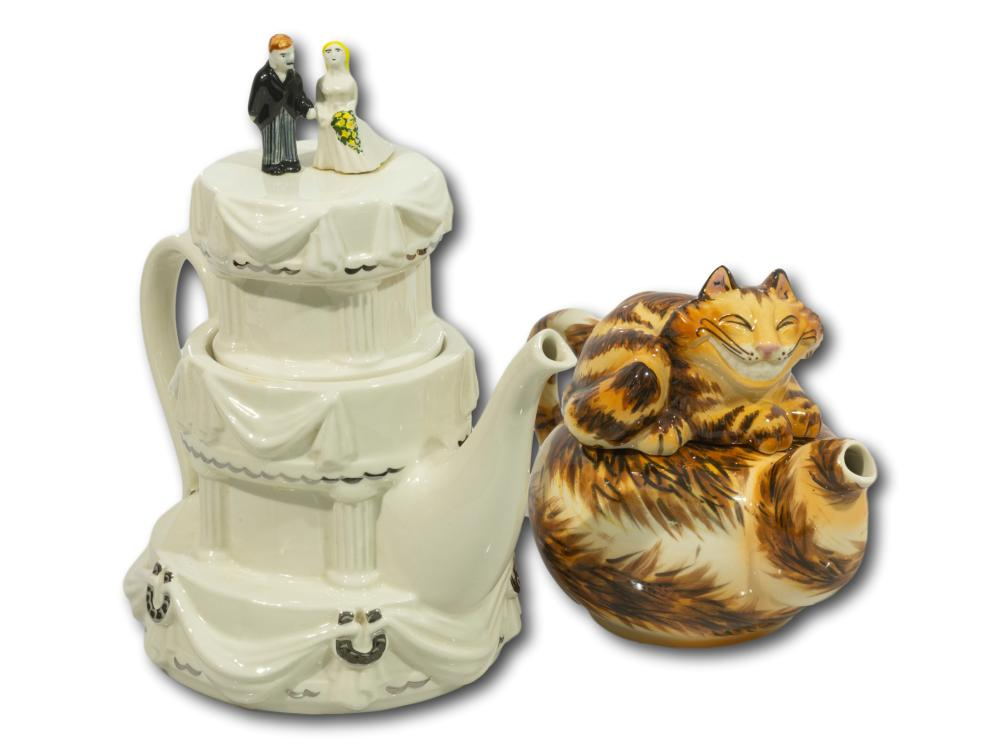 "A Paul Cardew ""Cheshire Cat"" Porcelain Teapot and a Moka 'Wedding' Porcelain Teapot"