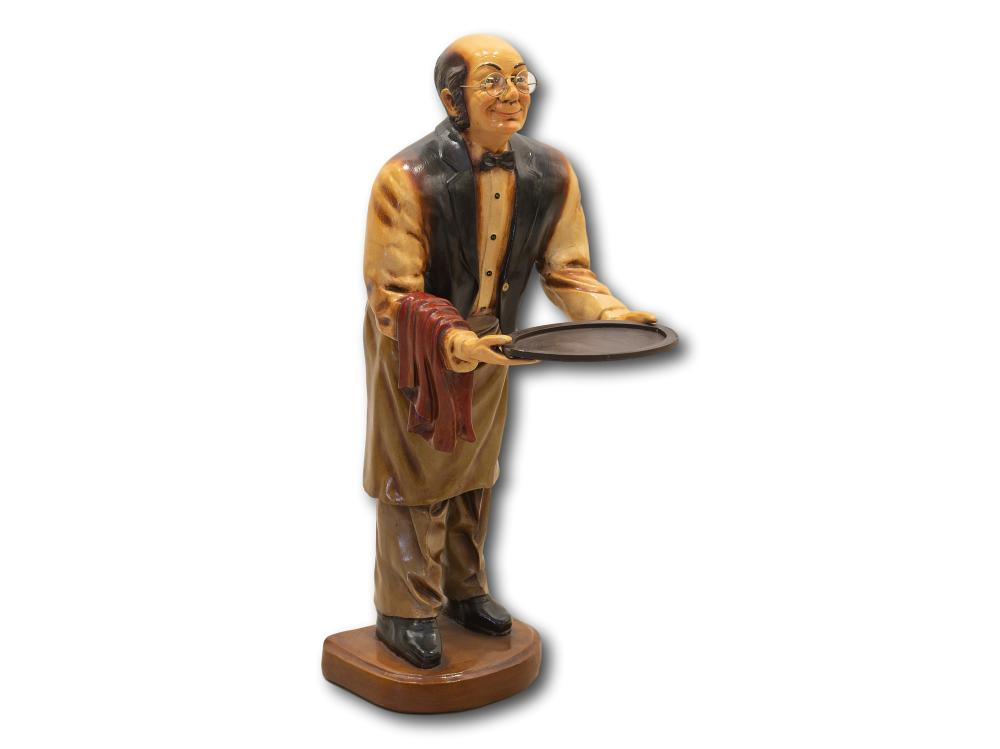 A Cast Resin Statue of a Waiter Holding a Removable Tray,