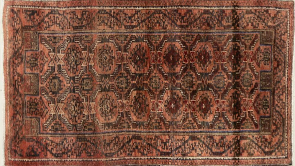 A Persian Hand Knotted Turkaman Rug, 148 x 85
