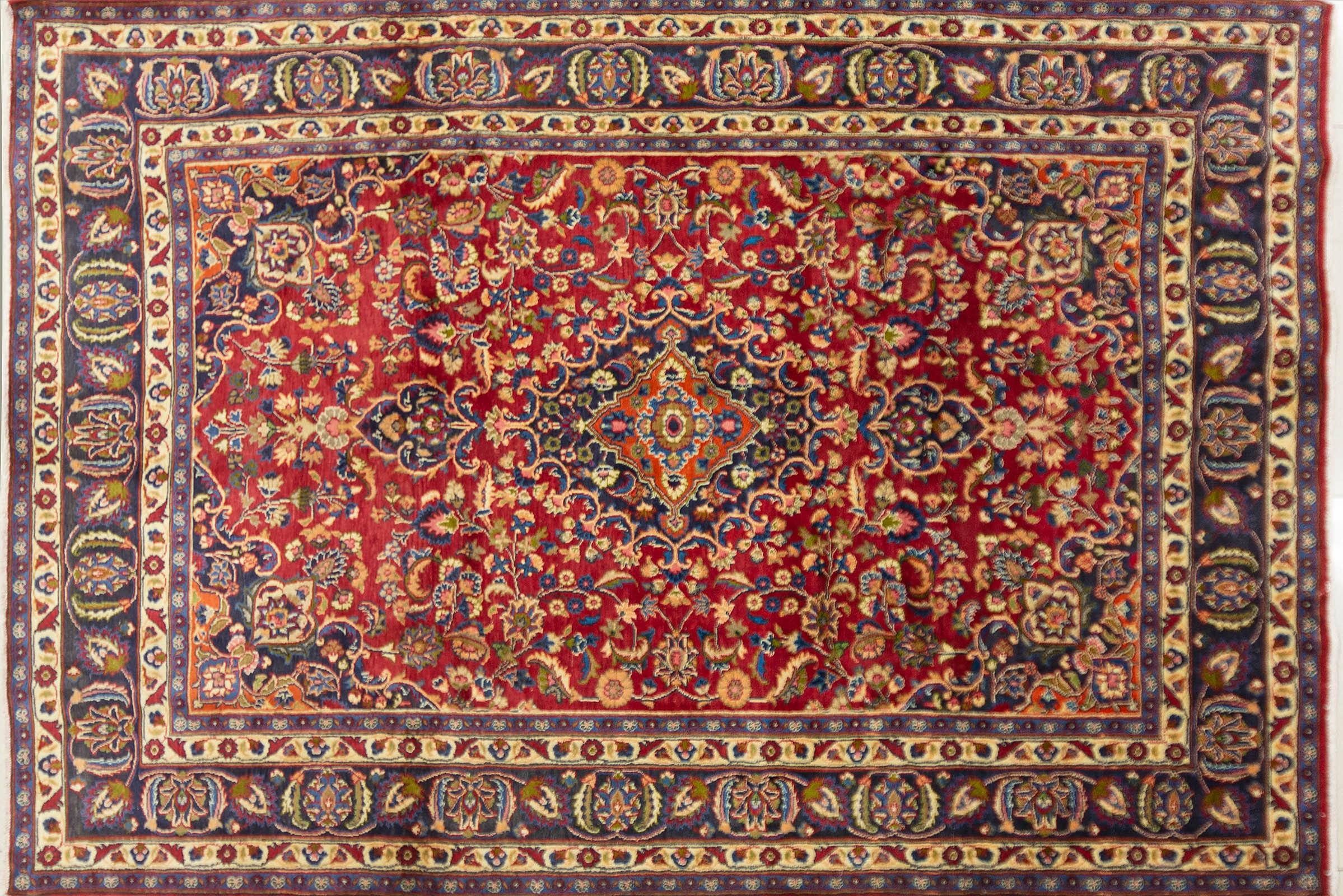 A Persian Hand Knotted Mashad Carpet, 300 x 200