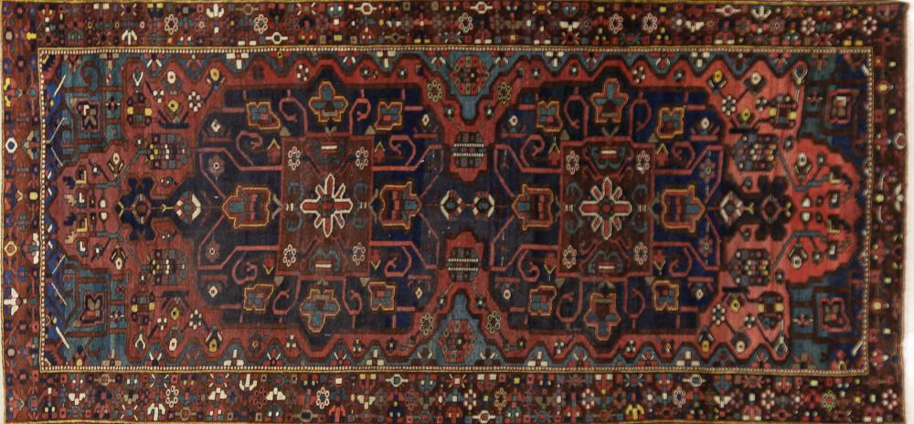 A Persian Hand Knotted Bakhtiari Carpet, 304 x 145