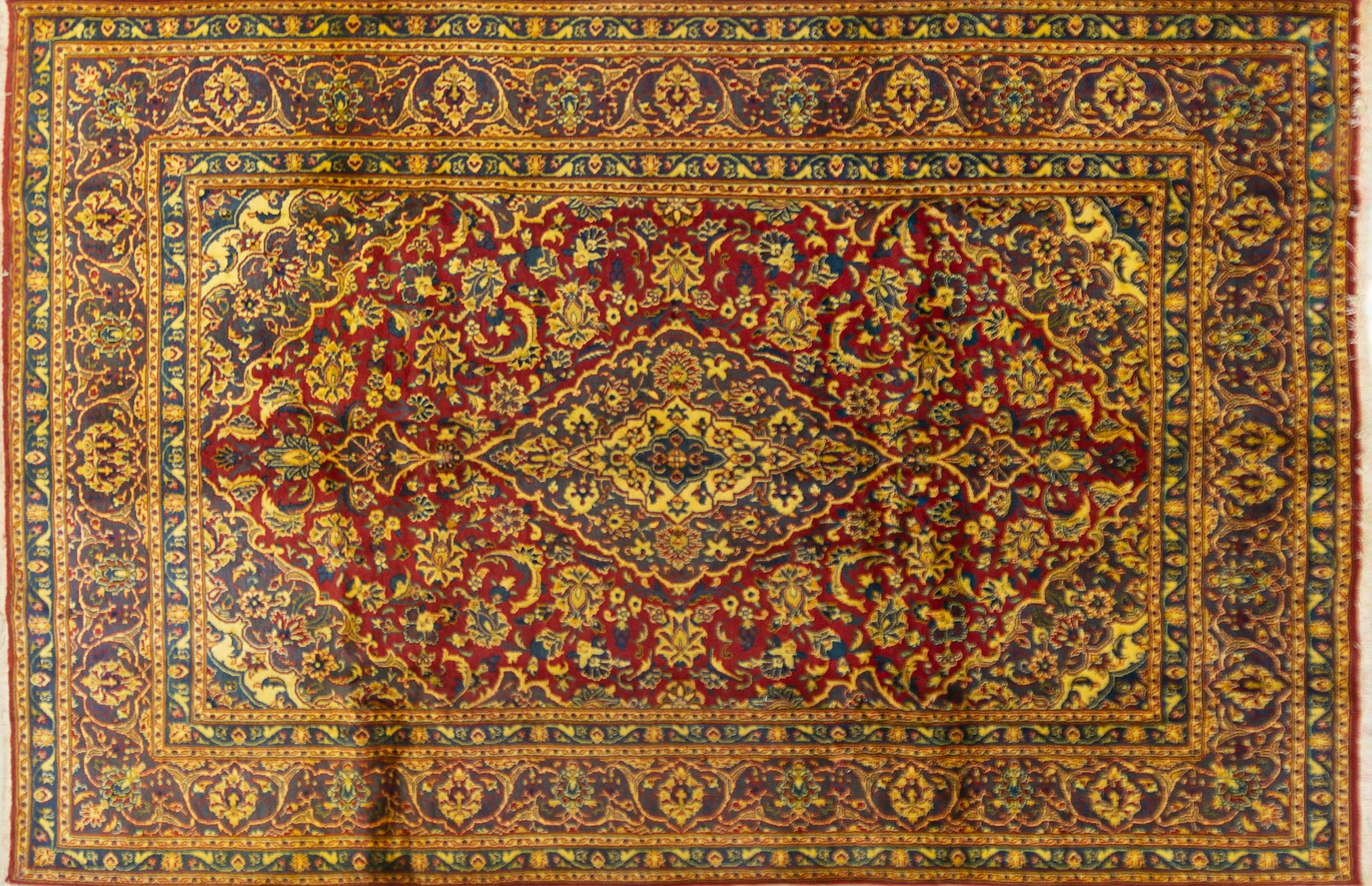 A Persian Hand Knotted Mashad Carpet, 292 x 190