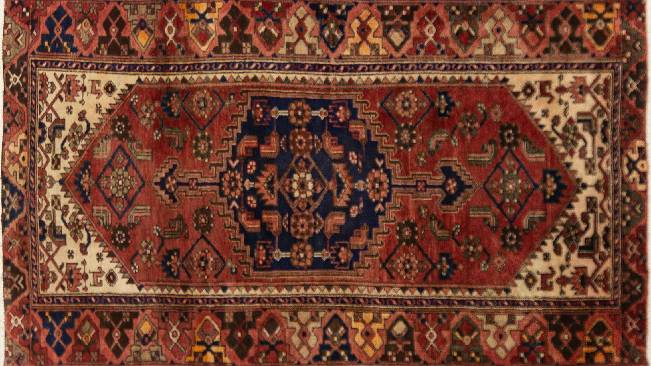 A Persian Hand Knotted Hamadan Rug, 215 x 120