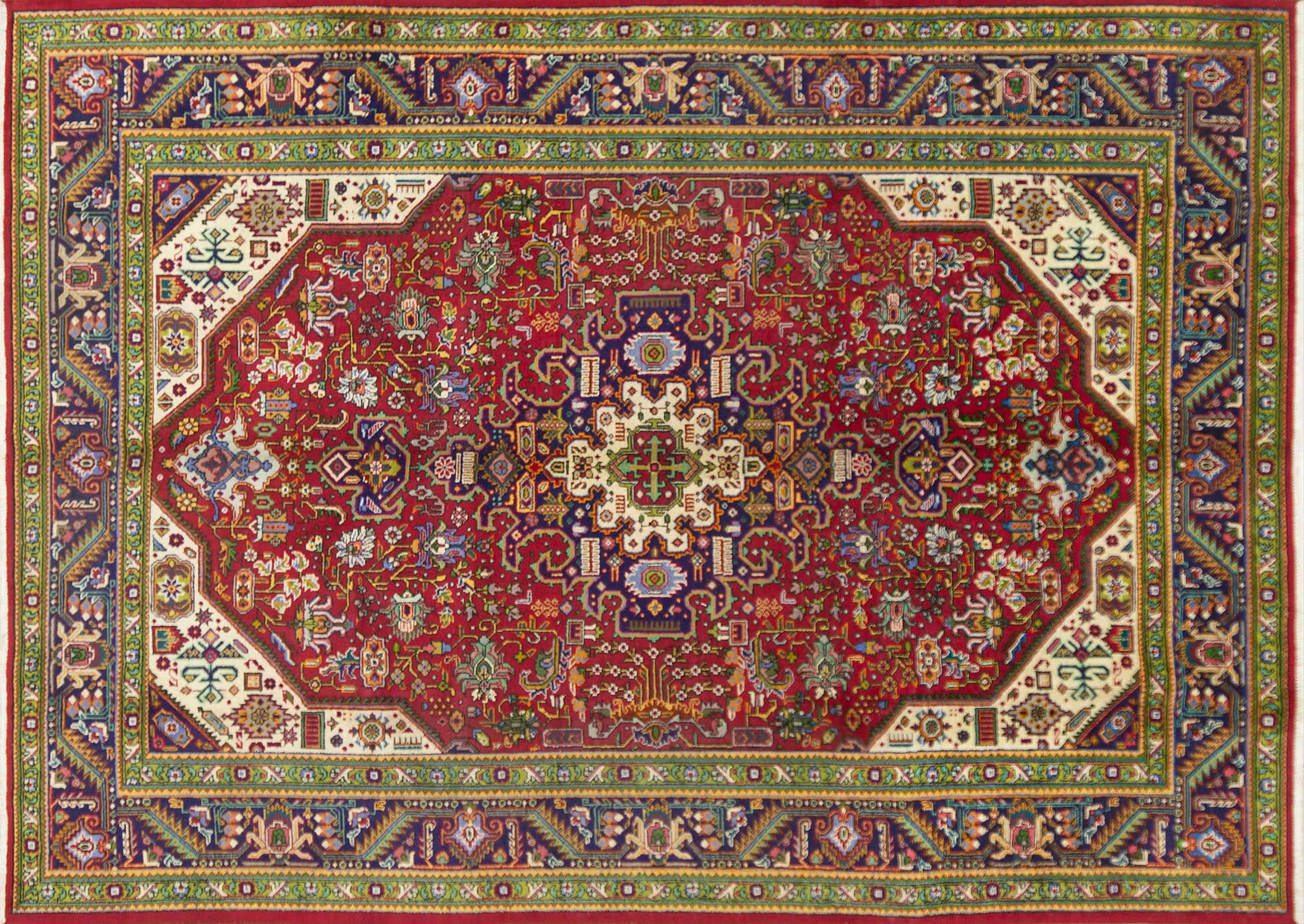 A Persian Hand Knotted Tabriz Carpet, 335 x 242