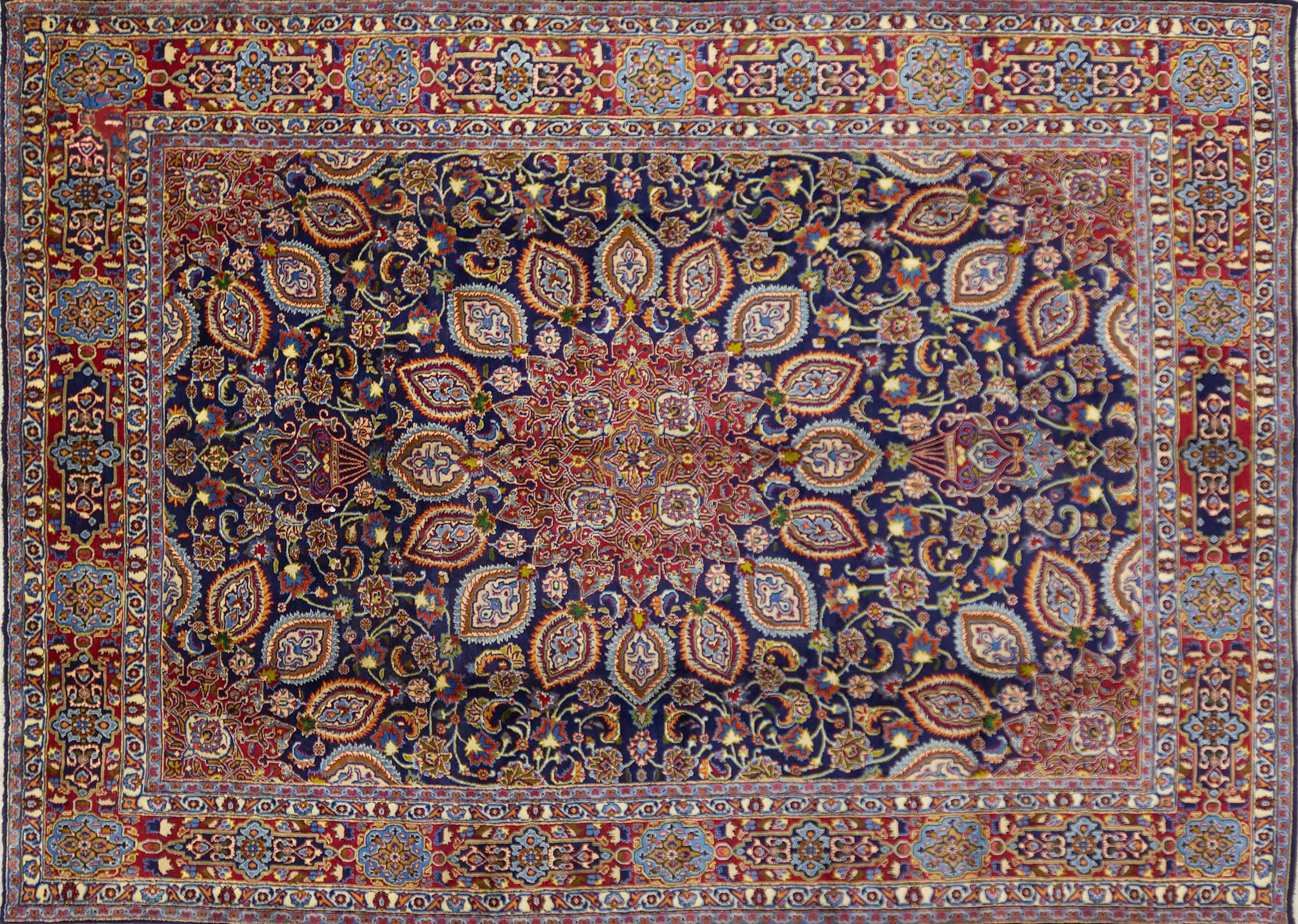 A Persian Hand Knotted Mashad Carpet, 407 x 286